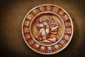 A carved Mayan calendar on textured background. Despite the provisional nature of calendars, two real phenomena govern almost all of them: the phases of the moon and the rotations of the sun. PHOTO: ISTOCK